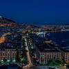 Dusk falls over a portion of the city and the harbor in Naples Italy.