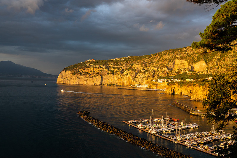 In Italy, the golden light of the setting sun casts the Sorrento Peninsula aglow.