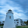 Piney Point Lighthouse as clouds roll by