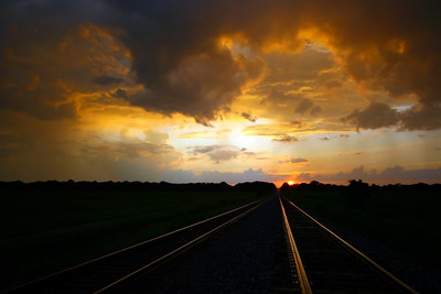 Beautiful Mississippi sunset after a storm rolled through. The water made the tracks light up with reflection! Oh what beautiful photos we get when we mix that Southern water with a southern sunrise or sunset! A beautiful delta sunrise or sunset! Southern transportation comes in all forms. From tractors to mules, from trains to boats!