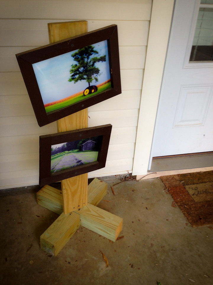 Outdoor photo display. Post your favorite photos as people come into your house with this farmhouse style photo display.