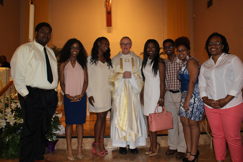 L to R: (Name unavailable), Amber Randall, Tiara Johnson, Father Tom Clark (Pastor), Channing Evans, Kristopher Goodly, MacKenzie Louis, Skyler Franklin.
