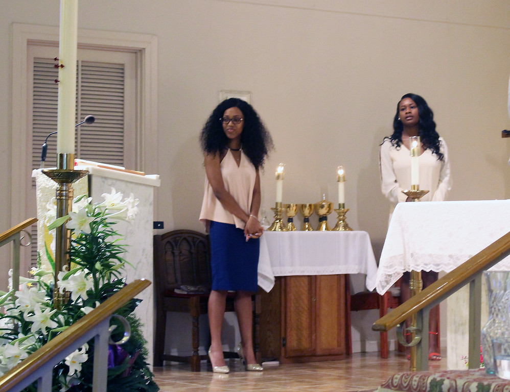 Amber Randall and Tiara Johnson on the altar at Immaculate Conception Catholic Church, Baton Rouge
