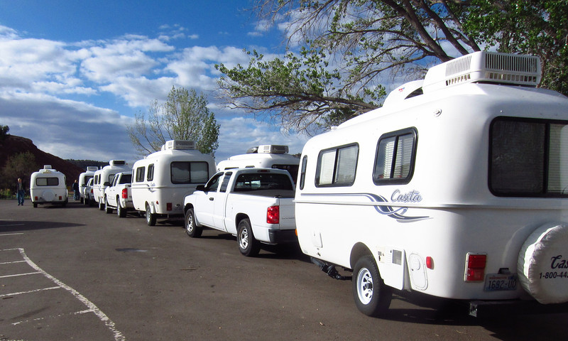 "Assemblage of 12 Casita trailers and 2 ""SOBs"" (some other brands) gathering for departure"