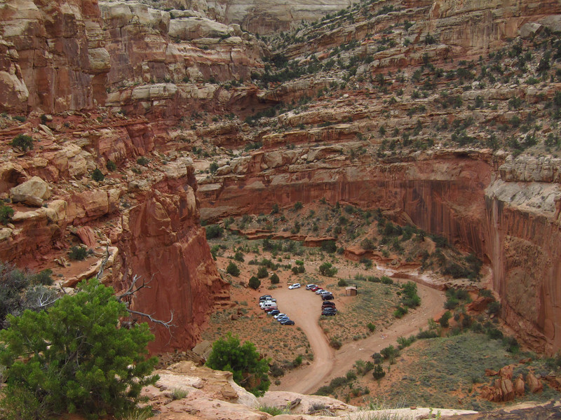I hiked about 800 feet to get to an arch high above the desert floor -- my car's in that lot.