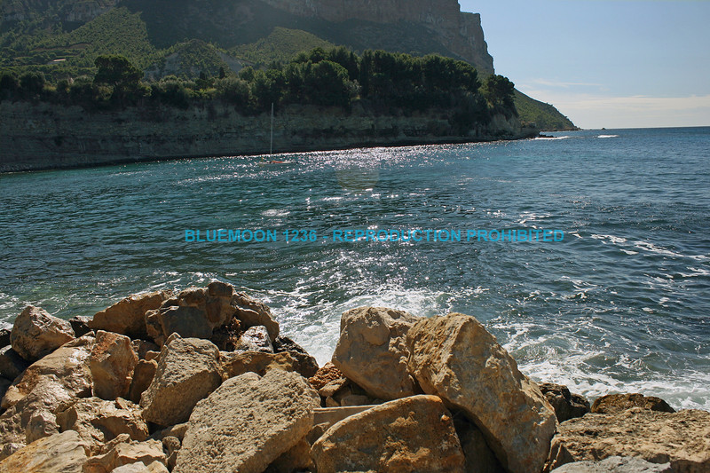 "Rocky, mountainous shoreline meets emerald green waters with bright blue sky in background bluemoon1236;  <a href=""http://www.bluemoon1236.smugmug.com"">http://www.bluemoon1236.smugmug.com</a> bluemoon1236;  <a href=""http://www.bluemoon1236.smugmug.com"">http://www.bluemoon1236.smugmug.com</a> ,Bluemoon Fine Photography"