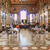 An open cafe inside the Galleria Alberto Sordi, a department store.