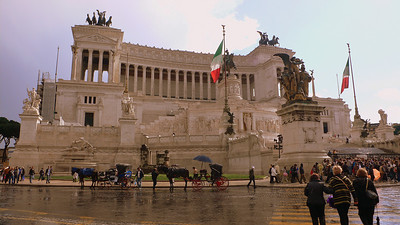 "Altare della Patria‎ (altar of the fatherland) seen after fresh spring rain. It was built to honour the first king of unified italy in Victor Emmanuel (1820 - 1878) after his death. Its sits on one of the seven hills of Rome, Capitoline Hill, and its construction effaced medieval ruins in the area. Locals refer to it as ""the typewriter""."