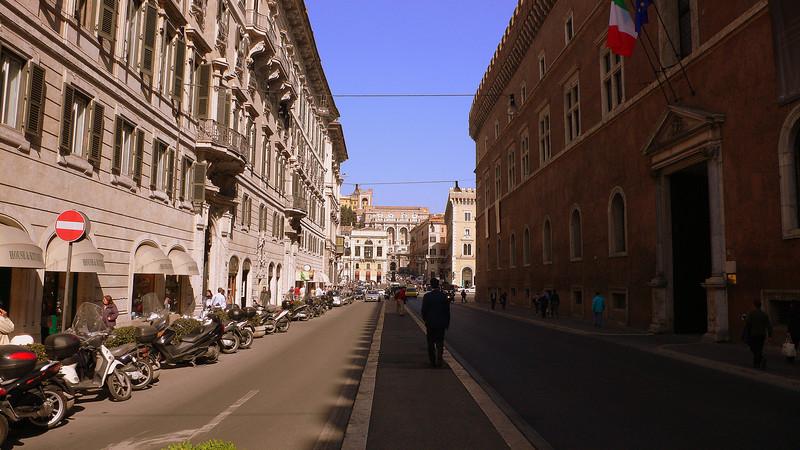 Roman Streetscapes : A narrow pavement leads on the Corso Vittorio Emmanuel II.