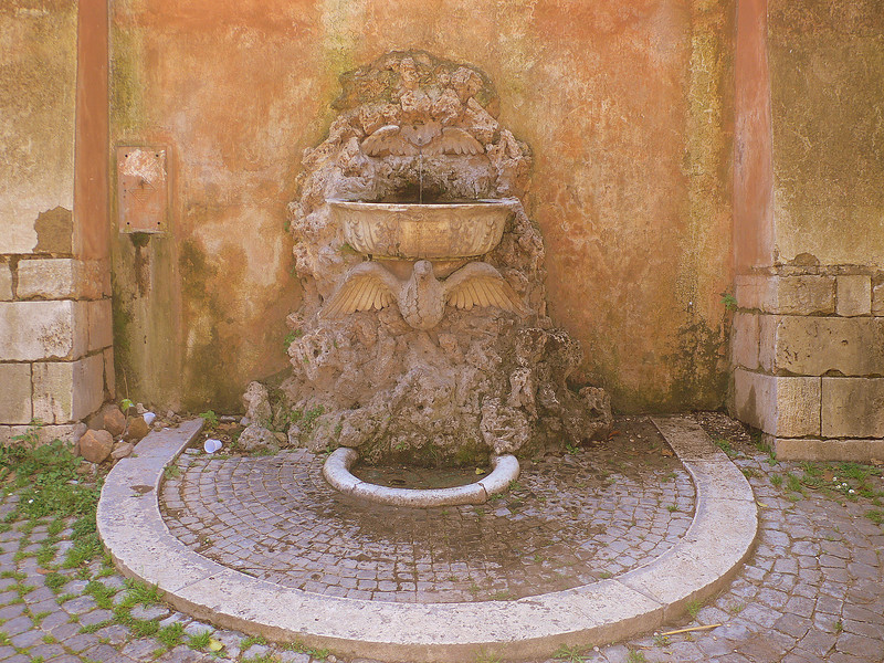 A drinking fountain at the Santa Sabina. The fresh water from these fountains is potable, and locals fill their flasks with the cool water regularly under the hot summer sun.
