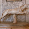 A sculpture of a hunting dog in the Vatican Museum.