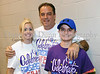 13 year old cancer survivor TJ Sansone with his parents Chris and Joe at Southlake's second annual Relay for Life/Rachel's Rally fundraising event for the American Cancer Society last Friday night at Carroll High School.