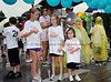 Regan Rilley and Matti and Isabell Pennington prepare for the children's walk portion of the North Texas Walk for PKD on a wet Saturday morning at Southlake Town Square.