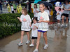 Regan Rilley and Matti and Isabell Pennington participate in the children's walk portion of the North Texas Walk for PKD on a wet Saturday morning at Southlake Town Square.