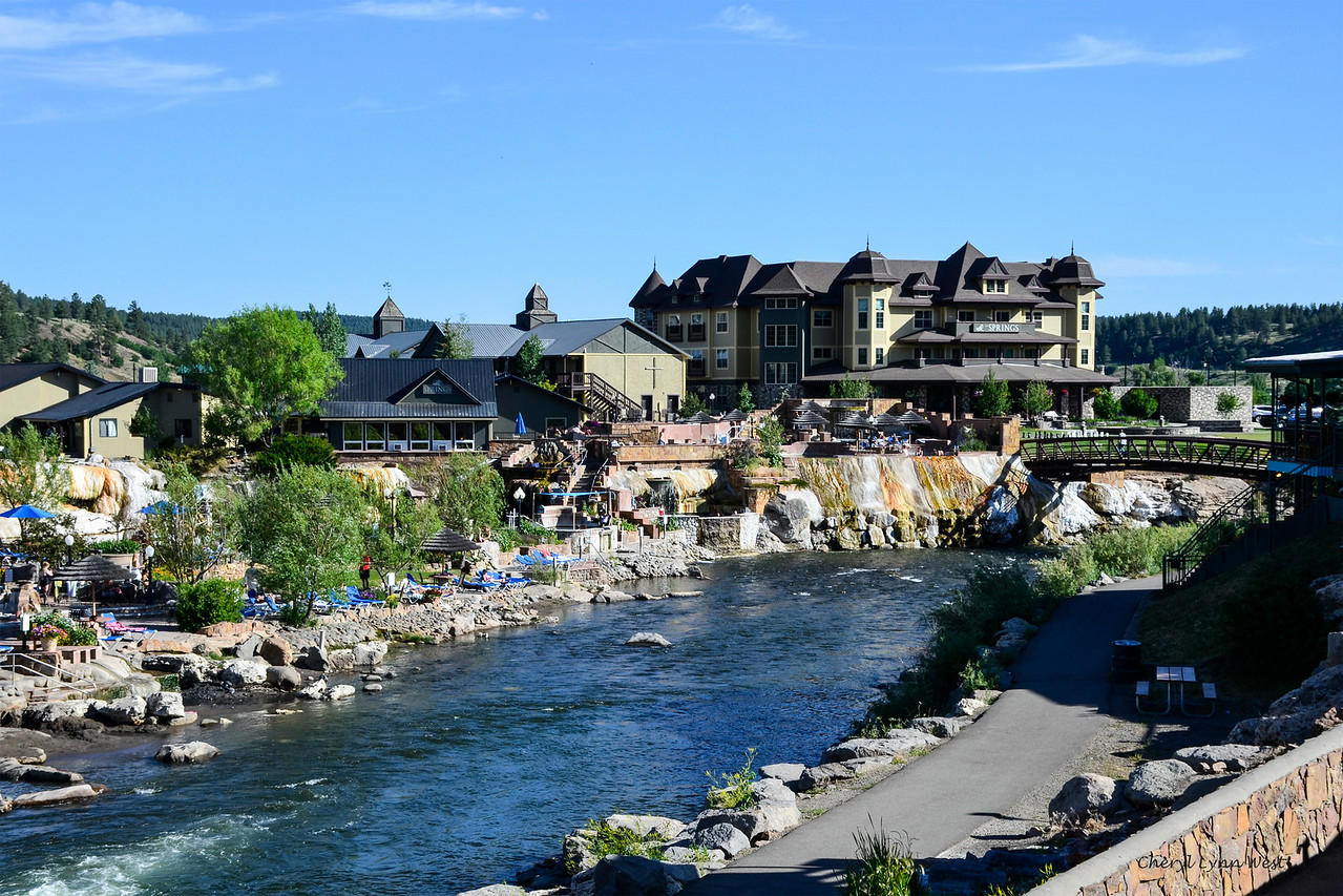 Pagosa Hot Springs, Colorado - People sunbathing near the resort and playing in the San Juan River