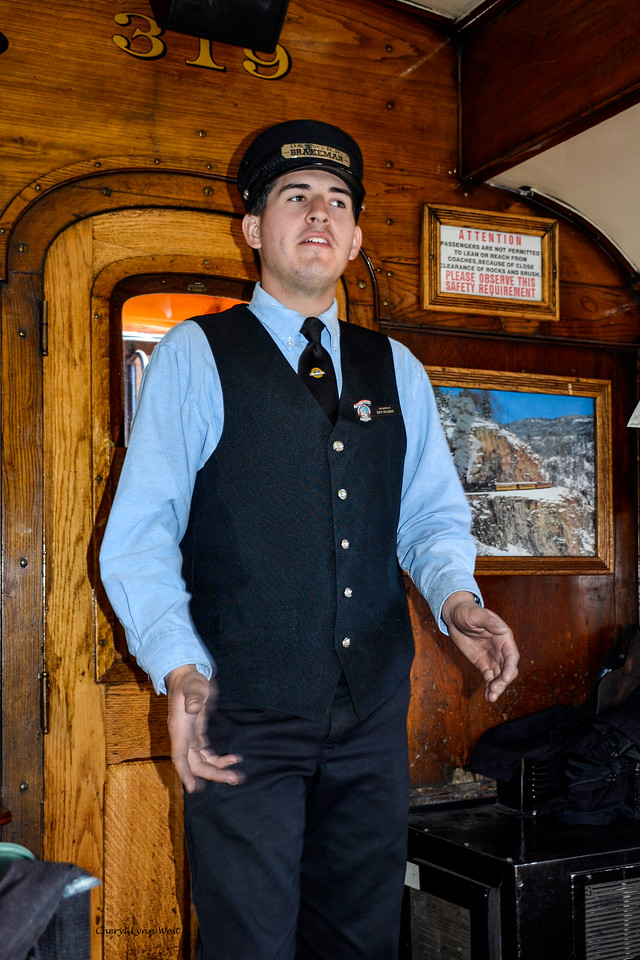 Durango & Silverton Narrow Gauge Railroad, Colorado - Brakeman giving information on the trip and safety instructions
