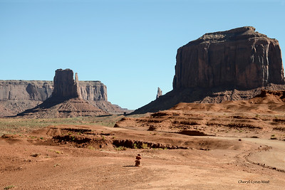 West Mitten on left and Merrick Butte on right, Monument Valley, Arizona - rock stack in foreground
