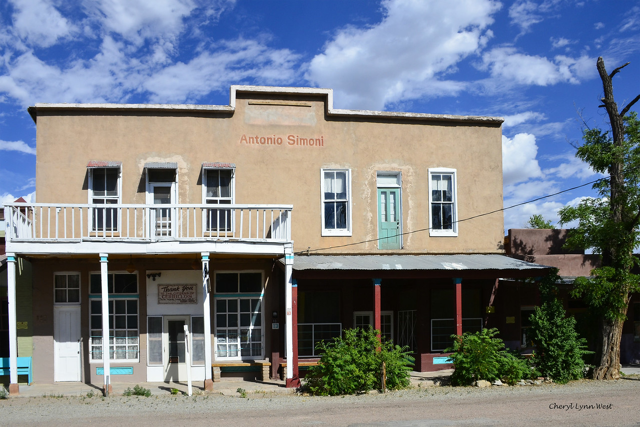Cerrillos, New Mexico - The Simoni Store and Wortley Hotel - Built in 1892, this two-story structure was a bar, drug and novelties store, sold dry goods, groceries and notions, a feed store, and a meat market. The upper floor were hotel rooms. In 1919 for $3,000 Antonio Simoni bought this building and operated his grocery here. Upon his death in 1956, this building passed to Edith and Corrina Simoni. Corrina, the last of the original Cerrillos Simonis, died in 2011. (Information from cerrillosnewmexico.com)