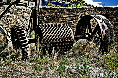 Madrid, New Mexico - Farming equipment behind the Madrid Old Coal Town Museum (HDR effect added)