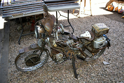 Santa Fe, New Mexico - Rusted motorcycle in one of the unique stores around town