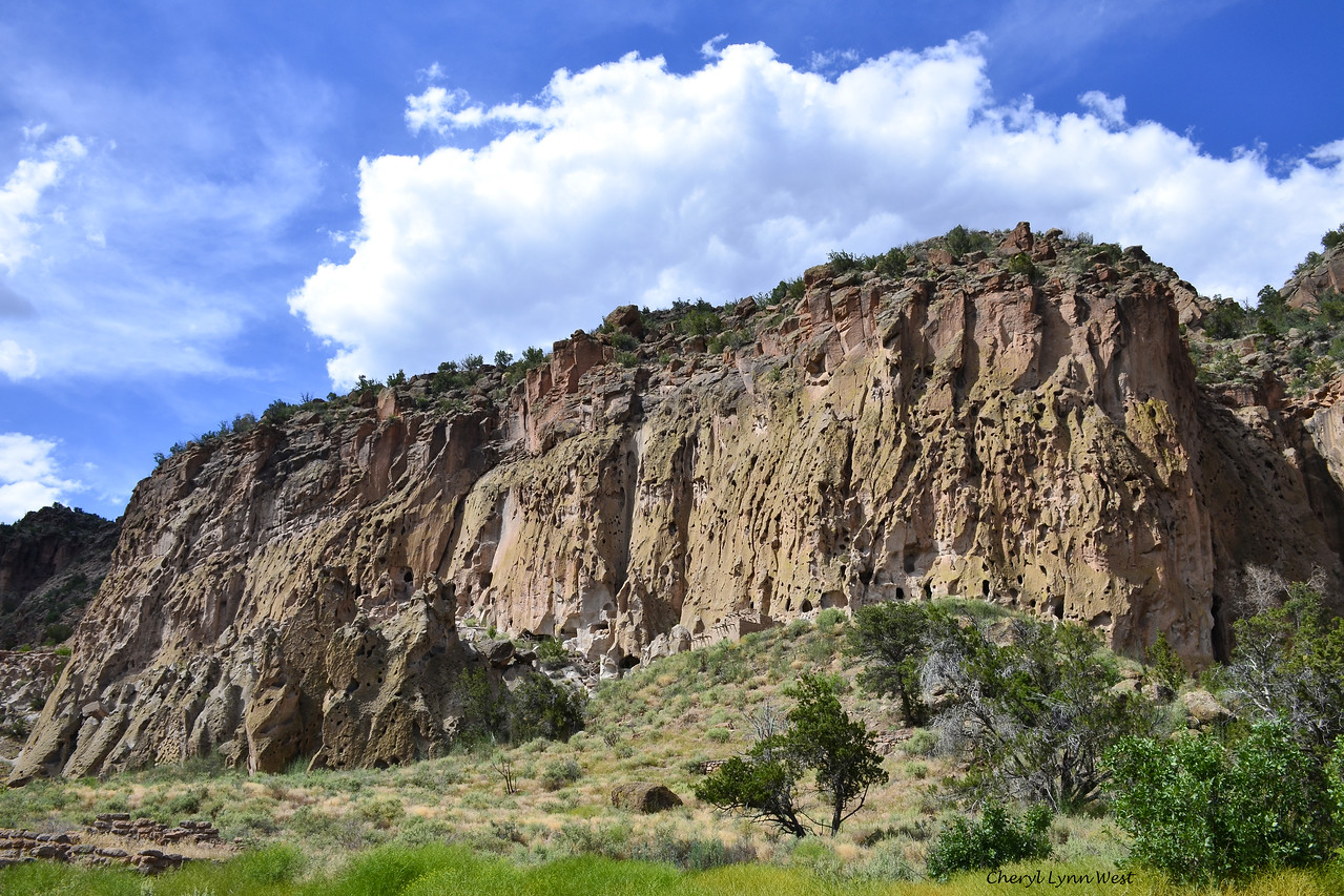 Bandelier National Monument, Los Alamos, New Mexico - We hiked along the trail at the base of the mountain in Frijoles Canyon, passing the adobe buildings and cliff dwellings which were the homes of the ancestral Pueblo people.