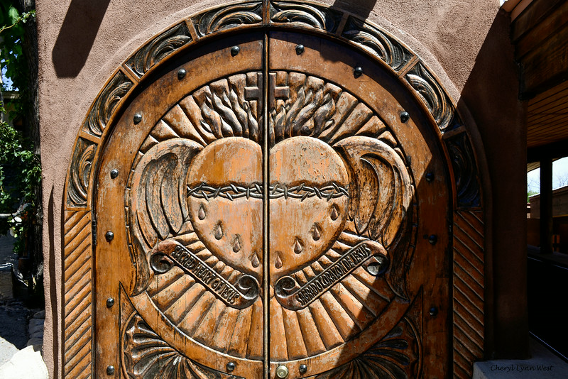 El Santuario de Chimayó, New Mexico - carved wooden door on one of the chapels