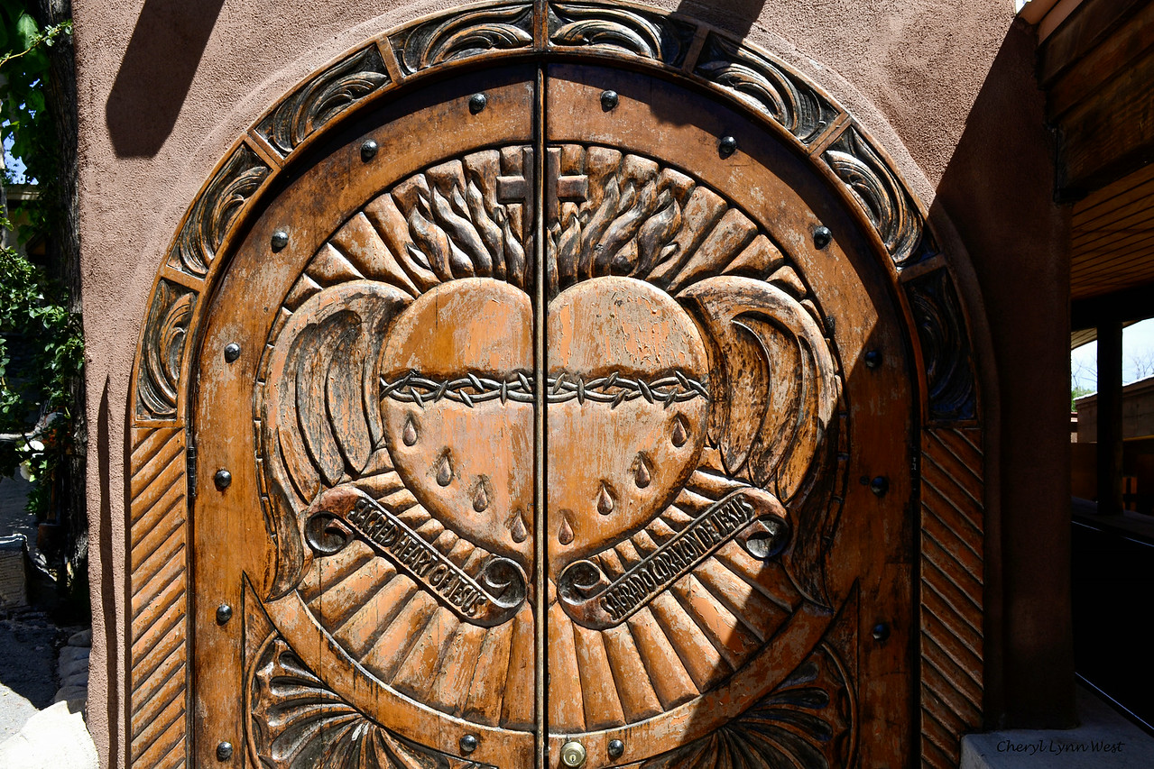 El Santuario de Chimayó, New Mexico - carved wooden door on one of the chapels