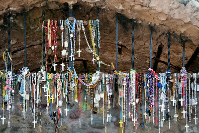 El Santuario de Chimayó, New Mexico - Small grotto with rosaries