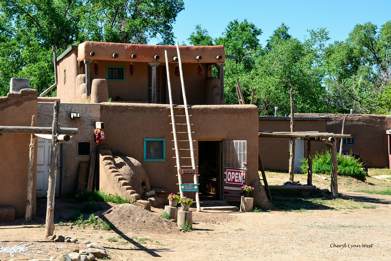 Taos Pueblo, New Mexico - Store and residence - the ladder is used to get to the second floor as there are no stairs inside.