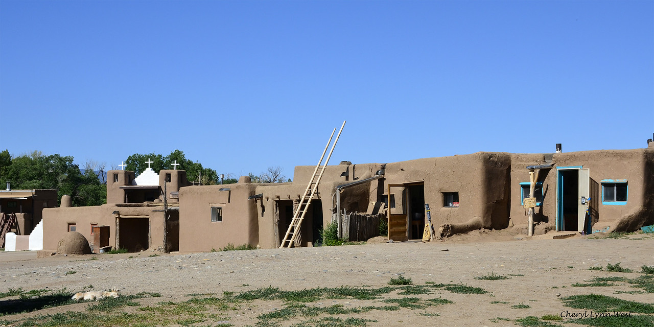 Taos Pueblo, New Mexico - The ladders are used to get to the floors above and the roof.