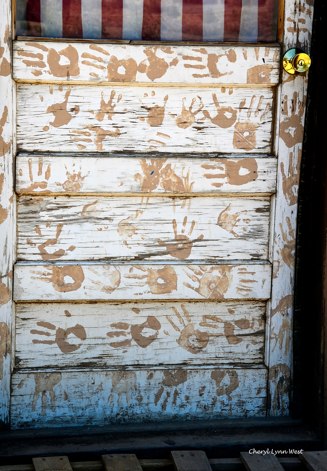 Taos Pueblo, New Mexico - Door with American flag and hand prints