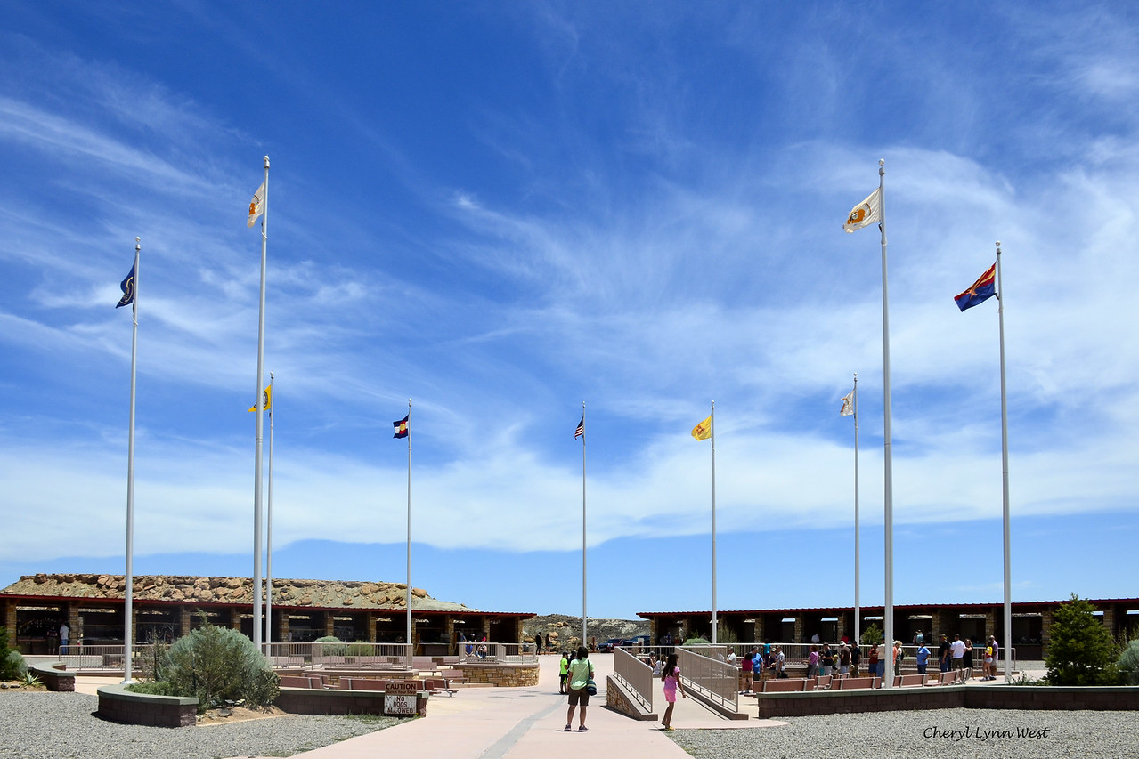 Four Corners, where the four states, New Mexico, Colorado, Utah and Arizona meet - USA flag and state flags