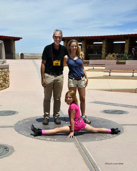 Four Corners - Peter, Betsy and Angelina Schreyer, posing on the marker