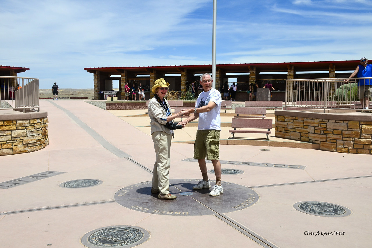 Four Corners - Barbara and Bruce Lieske standing on the marker, touching all four states at once