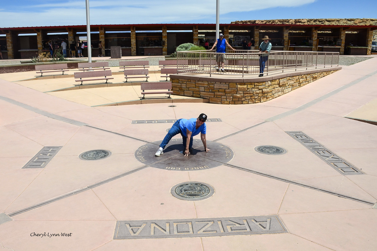 Four Corners - Cheryl standing on the marker, touching all four states at once