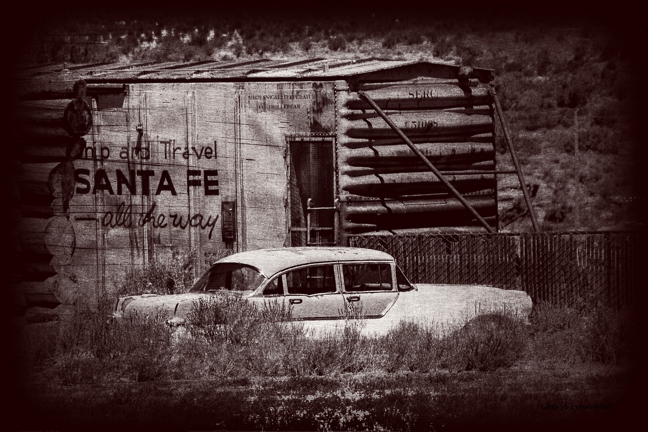 Abandoned car and boxcar, in a junkyard in the Utah countryside