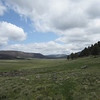 The Valles Caldera is an ancient, caved in volcano cone, which today is a giant meadow surrounded by mountains. Grande Valle trail.