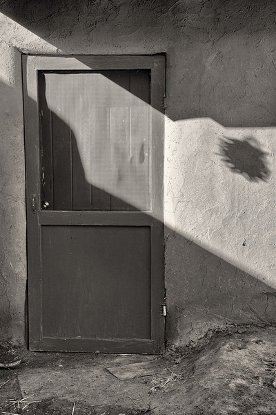 Door and Pepper Shadow<br /> <br /> Taos Pueblo <br /> Taos, New Mexico <br /> (5II2-11665)