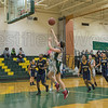 Southwick's Kaitlyn Haseltine put up a shot from the lane