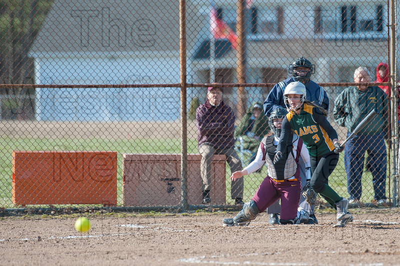 Nikki Willey smacks a hot grounder through the infield for a base clearing double