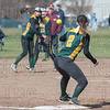 First baseman Gillian Ensign waits for the throw from Nikki Willey for the out