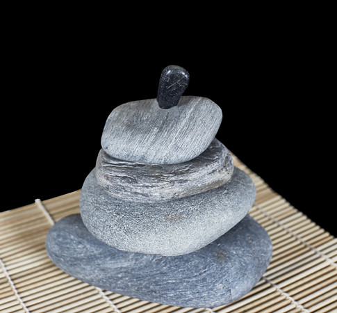 Stacked  River Rocks on Bamboo Mat