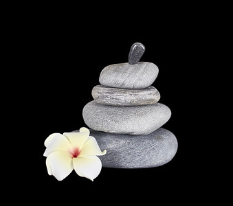 Stacked Rocks with a Plumeria Flower