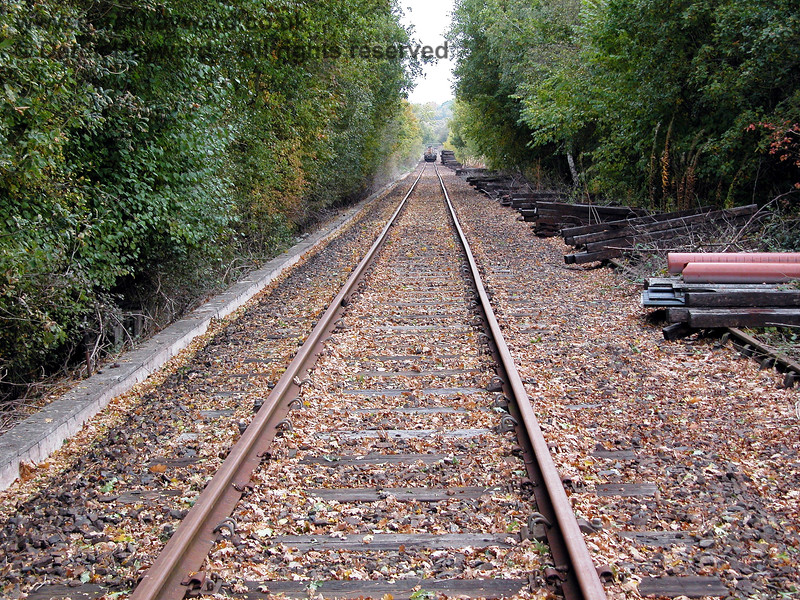 Looking south along the (then) disused line towards Birchden from just beyond the pile of sleepers.  Disused stock is in the distance. 19.10.2003