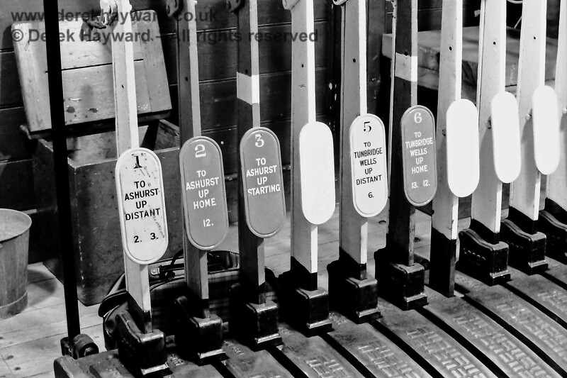 Levers in the frame at Birchden Junction signal box.  The main signal levers would be painted red, the distant signal levers yellow and the spare levers white.   See the next picture for the other end of the frame.  June 1970.  Eric Kemp retains all rights to this image.