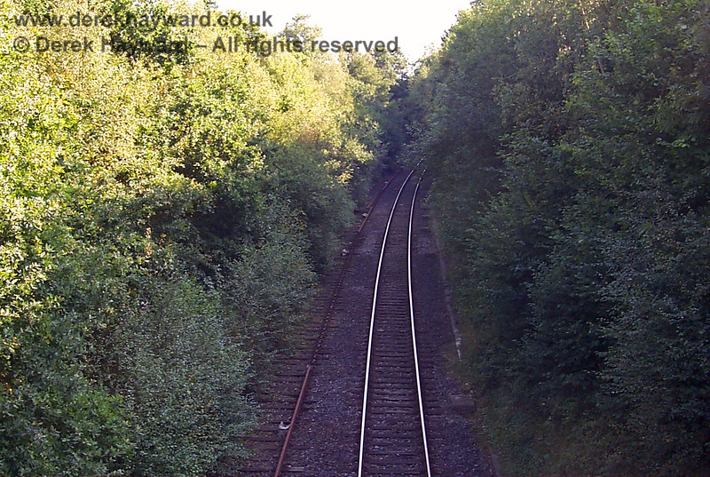 Another low resolution image from 1998 looks south towards Birchden Junction as the operational Network Rail line passes under the overbridge at Corseley Road.  The disused and heavily overgrown Down line is on the left, again with some random sections of rail removed.  19.09.1998