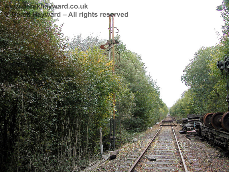 Now looking at the line down to Birchden, this old view from 2003 shows what was then the end of the operational track (denoted by the sleepers) adjacent to the old signal post south of Groombridge sidings.  Note that the area was then very overgrown. 19.10.2003
