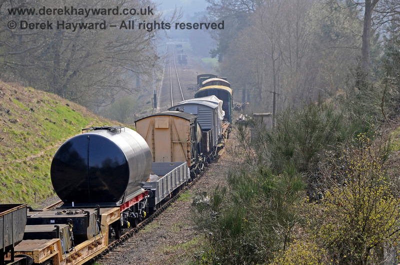 A view south down the siding formed by the former Up line, with a freshly painted tank wagon in view.  27.03.2011 6637