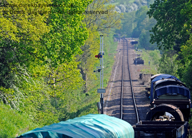 Looking down Birchden bank, with stock standing on part of the old Up line, which has been truncated into a siding.  29.05.2021 18054