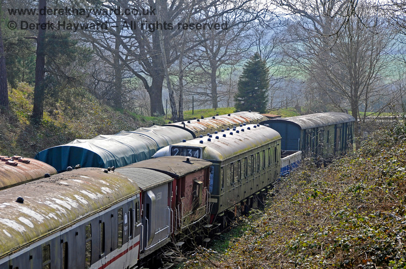 A further view of the Ashurst Spur sidings, with two brake vans and a coach from a DMU in view.  27.03.2011 6636